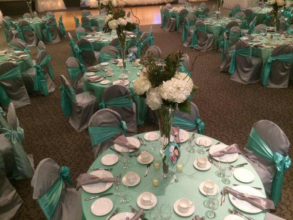 Now & Always mint and lavender wedding guest table settings with tall thin floral centrepieces