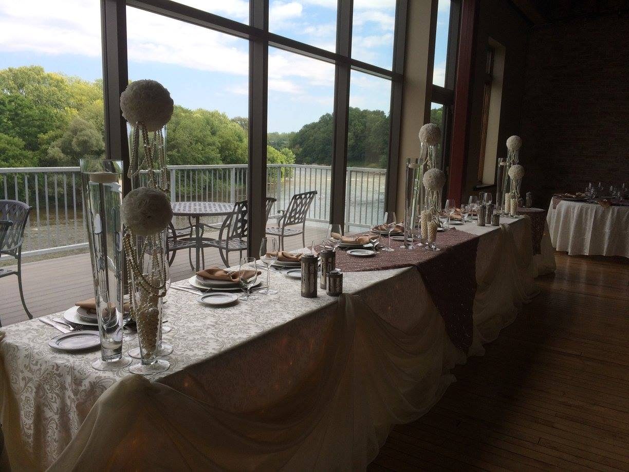 Now & Always long head table set against a large window overlooking green space