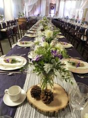 Now & Always long wedding table with purple and white linens