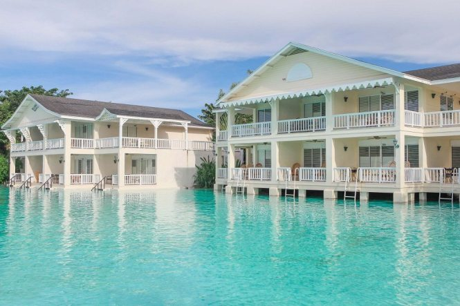 Live on the Edge of a Sparkling Lagoon at Plantation Bay ...