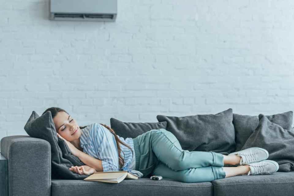 lady sleeping on sofa