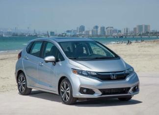 "Two questions with similar themes percolate throughout the auto industry. Consumers want to know the best car for the money and the best car money can buy. The answers are subjective. But the first question is more relevant to more buyers, and so here's one vote for the 2018 Honda Fit. Now in its third generation and 11th year since replacing the Honda Civic hatchback, the Fit is a five-door subcompact with more interior room than its appearance indicates. Versatile, well-constructed inside and outside and value-priced, the little engine that can is arguably the best new car available in the United States for less than $20,000. The 2018 Fit is available in LX, Sport, EX and EX-L trims. All Fits have 1.5-liter, four-cylinder engines with front-wheel drive. A standard six-speed manual or optional continuously variable transmission (CVT) is available except on EX-L trim. It only has a CVT. With a manual transmission, the engine is rated at 130 horsepower. The new Sport trim (my test vehicle) has a 7-inch touchscreen interface that connects with Apple CarPlay and Android Auto and a six-speaker sound system. A few new styling extras include 16-inch alloy wheels, foglights and a leather-wrapped steering wheel and shift knob. Also new for 2018 is an upgraded suspension and improved safety features. The Fit's interior space is impressive, including ample legroom in the back seat. Like many vehicles with manufacturer's claims of five-passenger seating, the Fit is more appropriate for four adults. The second-row seating called ""Magic Seat"" is innovative. The 60/40-split rear bench folds flat into the floor, and the seat bottoms prop up to provide upright space for tall objects. With both rear seatbacks folded down, the Fit has 52.7 cubic feet of cargo room, not too much less than some smaller crossovers and the best in its segment. With the Fit's front passenger seat folded flat, items nearly eight-feet long will fit. The Honda Fit shouldn't be expected to break land speed records. But for its class, it's no slouch. Its 0-60 mph test speed of 8.8 seconds is among the strongest in its segment. Gas mileage averages are 29 miles per gallon in city driving, 36 miles per gallon on the freeway. On the open road, the Honda Fit drives predictably. It's a lightweight vehicle, so it doesn't have a lot of authority. And compared to previous years' models, the new Fit has more engine noise at freeway speeds. With three two friends and a combined occupant weight of about 550 pounds, the new Fit fared well and without issues on a 275-mile round-trip from Sacramento to Half Moon Bay. The engine's high pitch is prevalent, particularly exceeding 70 miles per hour. But it's not problematic. Still, the Fit is at its best in city driving. It maneuvers well through traffic, has a tight turning radius and is confident, as it should be, in tight parking spaces. Overall road vision is impressive, in part because the Fit has 10 windows. It's another reason why the Fit has a larger presence than its subcompact status. The manufacturer's suggested retail price (MSRP) for the top-line EX-L model just surpasses $20,000, but the remaining fit trims are all less expensive. The MSRP for the Sport model is $17,500. With its delivery charge, the total is $18,390. The topic of best car money can buy is still open for discussion as is the best car for the money. But the 2018 Honda Fit makes its case just as it has for the past decade."