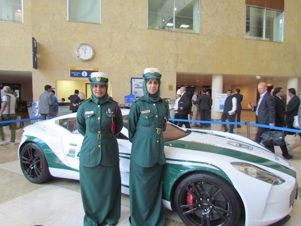 Dubai police women and a Bugatti Veyron police car.