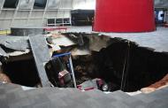 gluttonous sink hole eats eight rare Corvettes