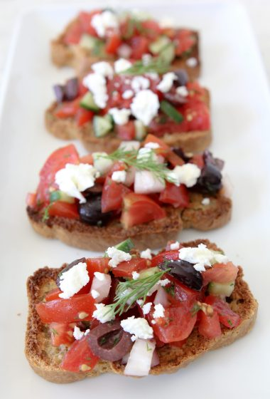 Paleo Greek Bruschetta from the Whole Smiths. A fresh twist on the classic using Simple Mills Artisan Bread Mix. Gluten and grain-free, paleo-friendly.
