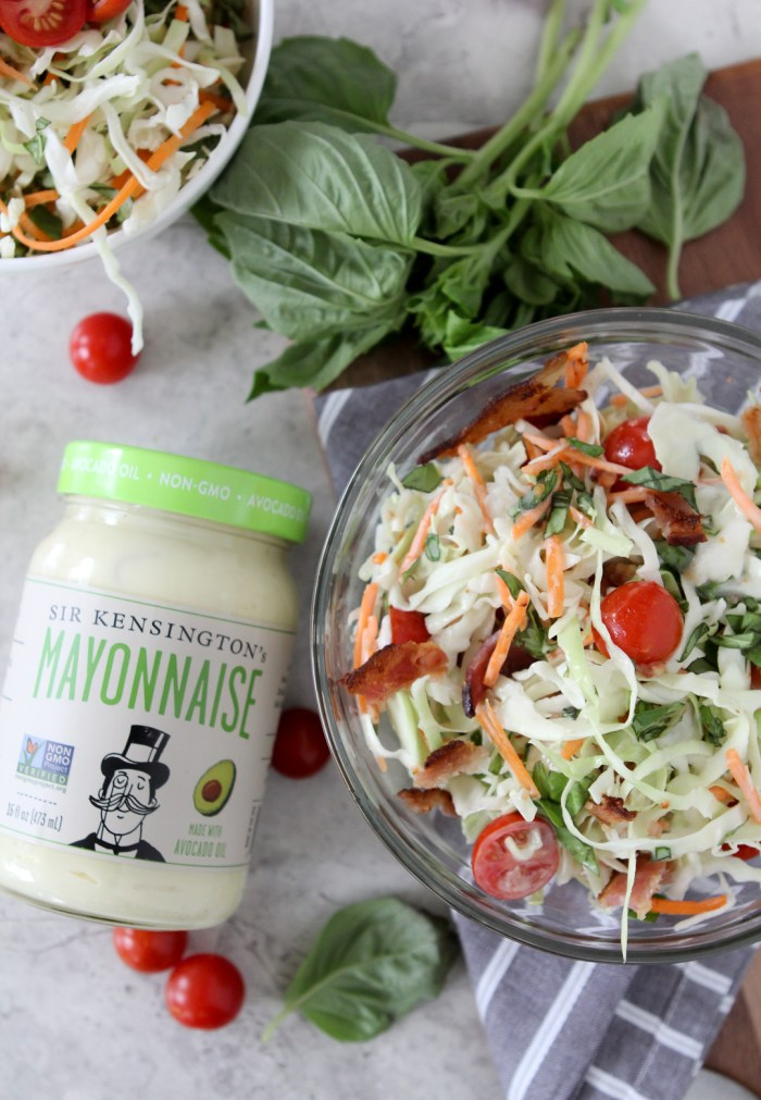 overhead shot of a bowl of Paleo BLT Coleslaw with a jar of paleo mayo on the side