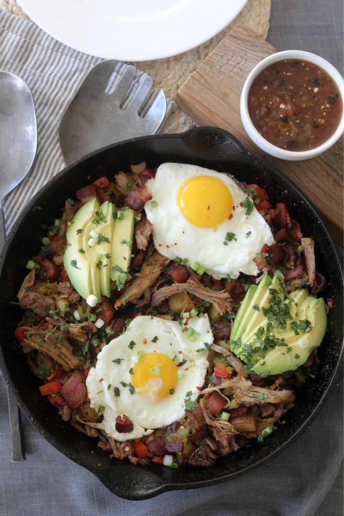 A delicious paleo Pulled Pork + Bacon Hash from the Whole Smiths that you'll want to make over and over again. Whole30 and gluten-free.