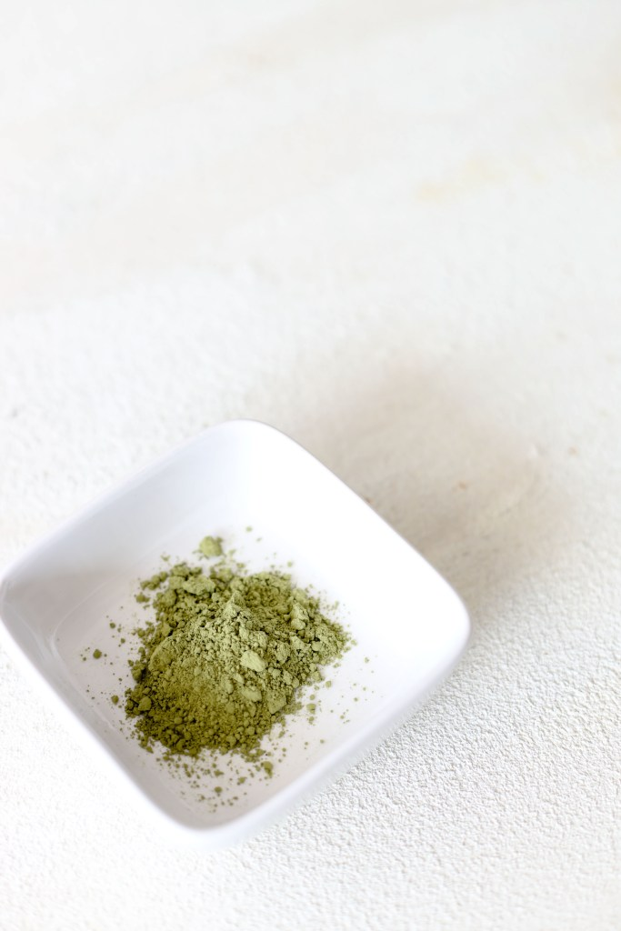 matcha green tea powder in a small white dish