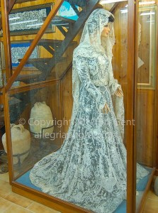 An antique lace wedding dress in Burano, Italy