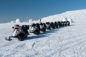 Snowmobiles lined up on Two Top Mountain