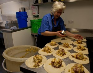 Owner Elaine Eads filling pasties at the Chough Bakery, Padstow, Cornwall