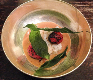A mound of crab meat accented with tomatoes and sage leaves