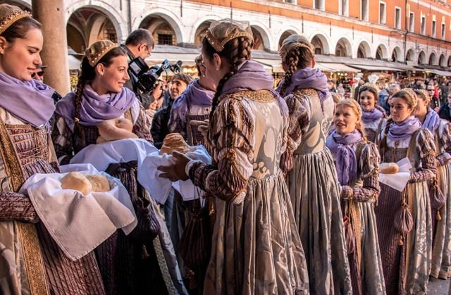 Sharing the loaves of bread, Festival of the Bull, Venice, ©BillGent