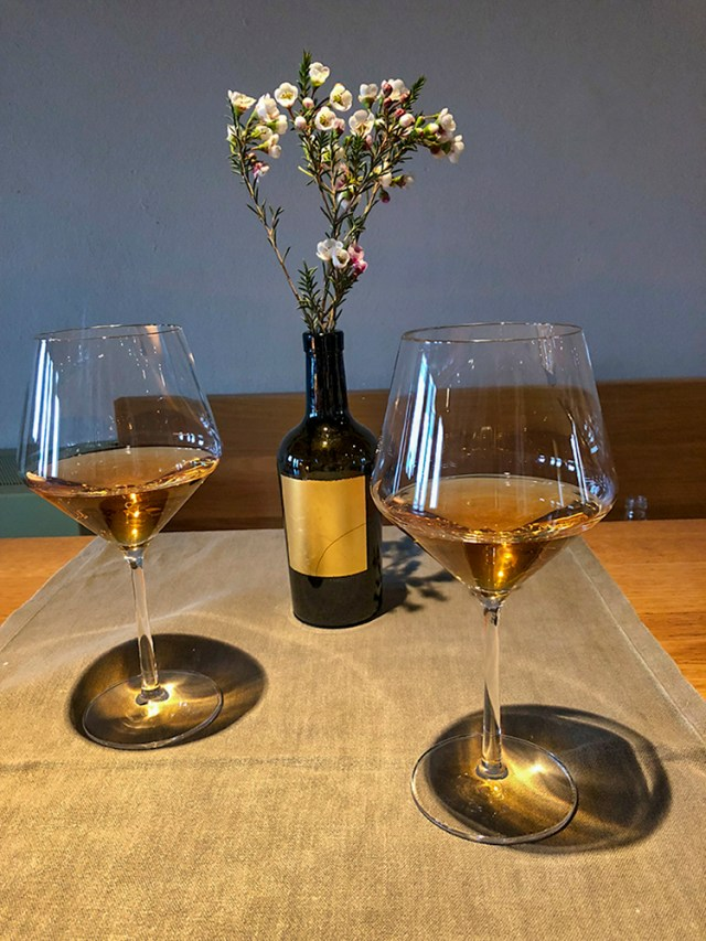 Two glasses of golden Dorona di Venezia wine