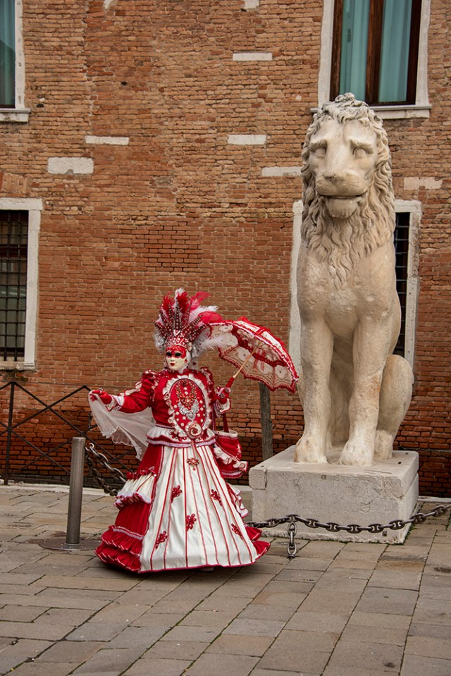 Posing with a lion outside the Arsenale