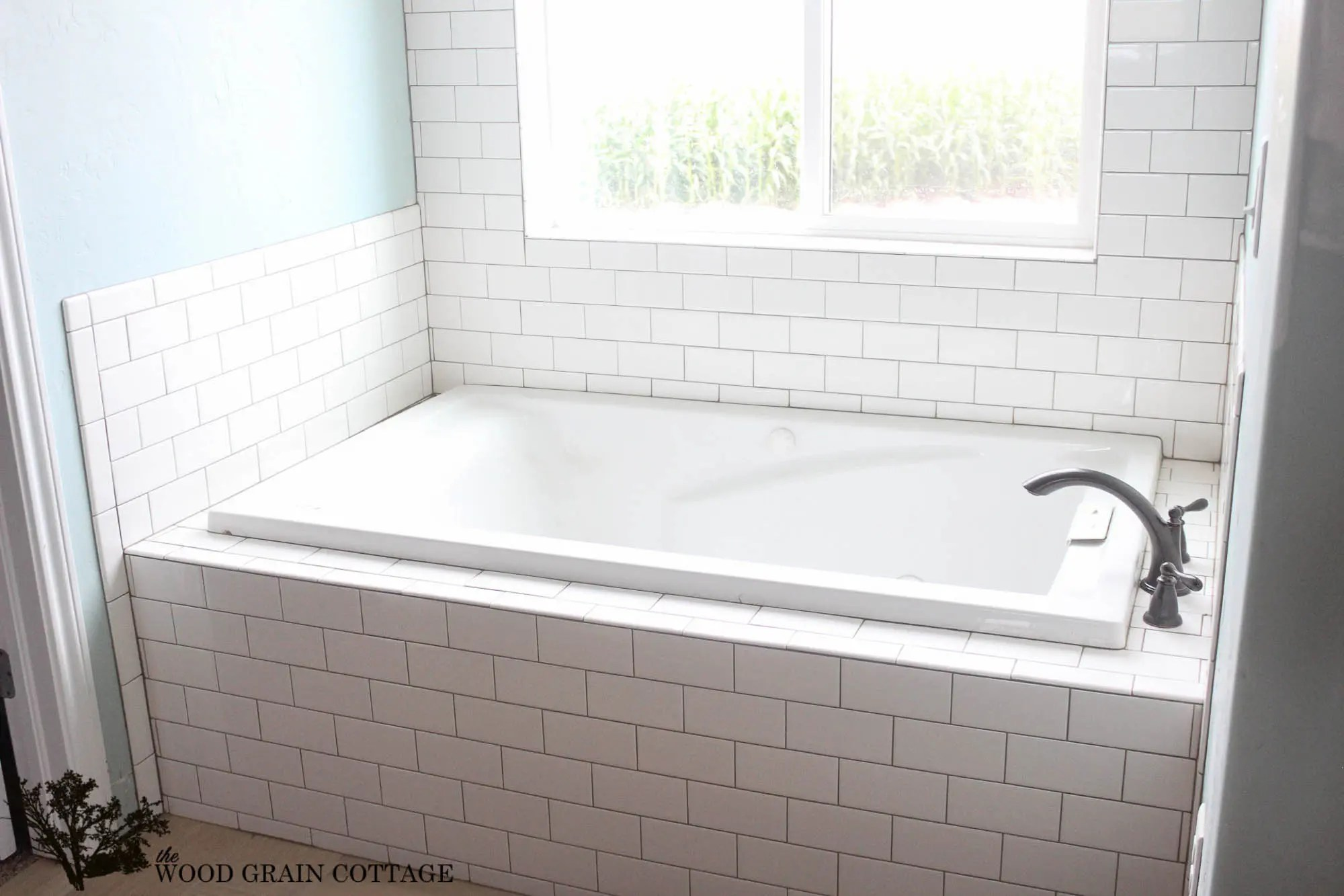wood grain porcelain tile bathroom with dark floor