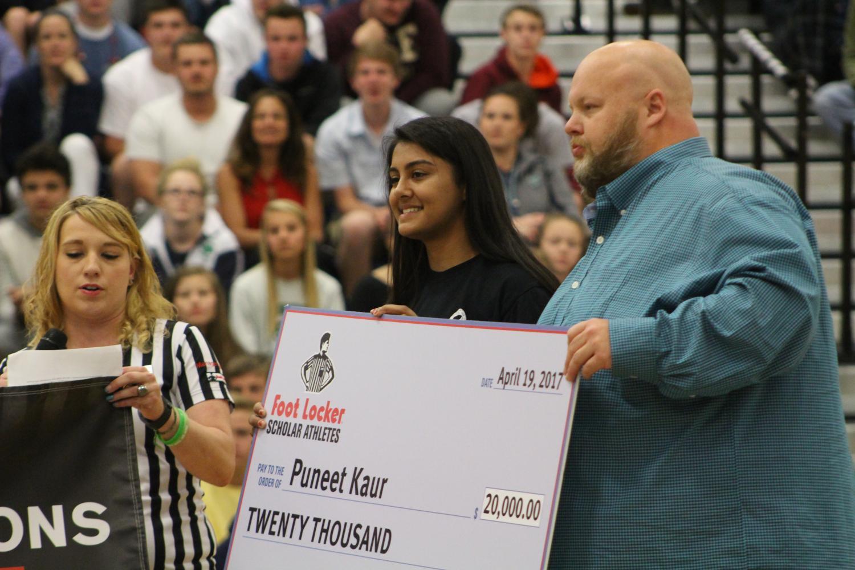 Senior Puneet Kaur receives a 20,000 dollar scholarship from the Foot Locker Scholar Athletes Program.