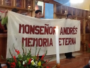 Seminarians hold banner commemorating the 1 year anniversary of  Fr. Andres' falling asleep
