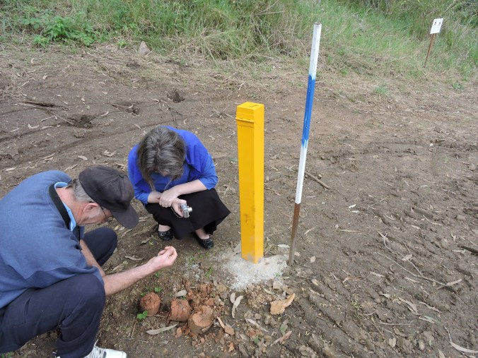 33 Mick and Melanie examine pole put up by road company and clay