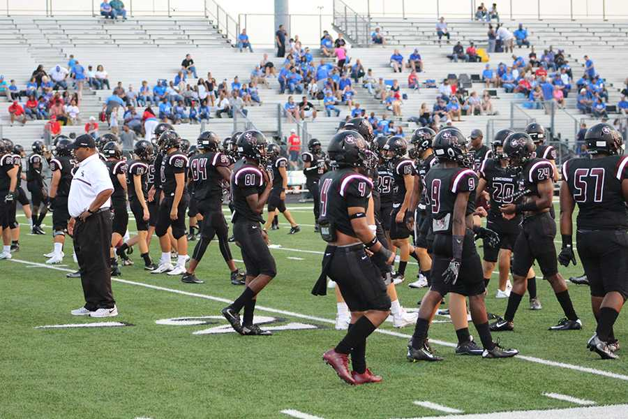 Longhorns+varsity+Football+Team+mentally+and+physically+get+set+for+the+game.
