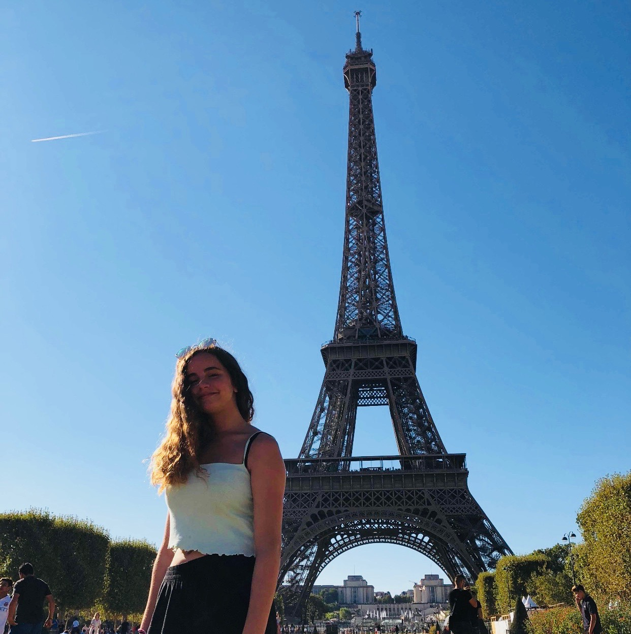 Guehria in front of the Eiffel Tower during her trip this past summer.