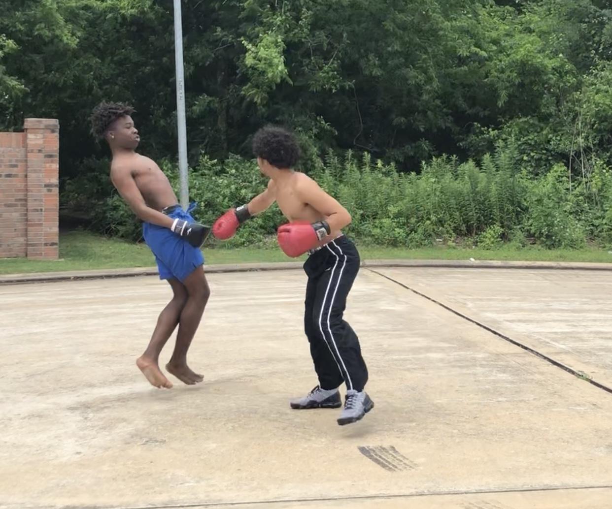 Outside of my house boxing my friend, Rhaman Anifowoshe.