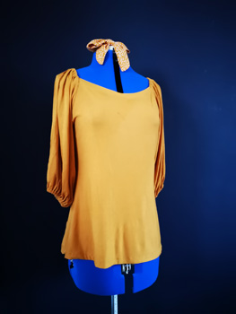 Yellow Coloured Blouse With Gathered Shoulders And Sleeve Hems on Blue Mannequin with Yellow Hair Tie