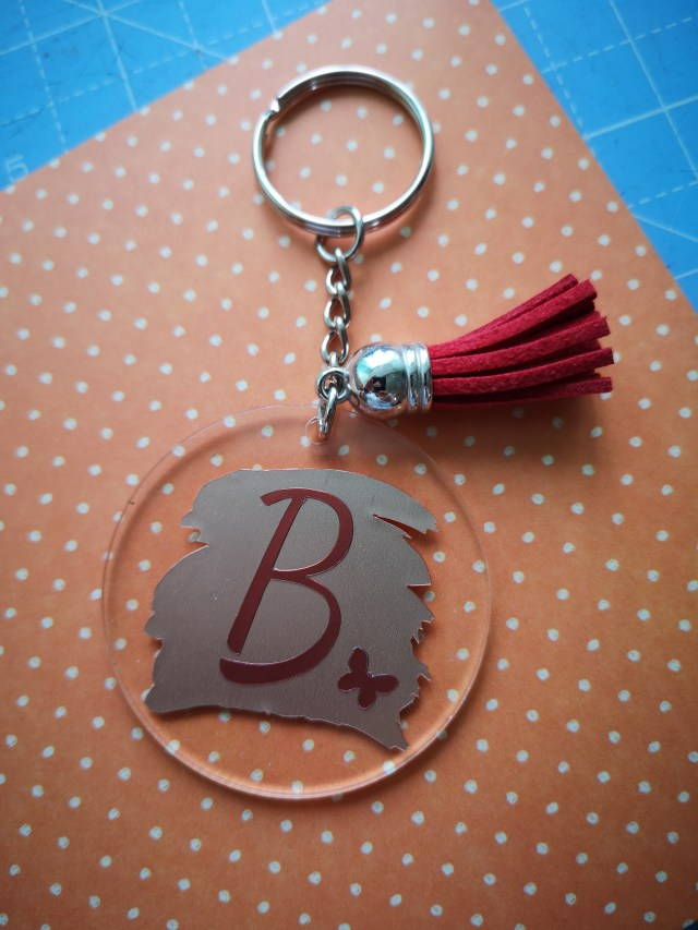Handmade Keyring With The Initial 'B' And Butterfly With Red Tassle On Orange Polka Dot Card