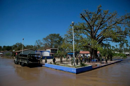 Soldiers arrive to check on village residents staying dry on a raised village plaza surrounded by receding flood waters, two days after the passage of Hurricane Patricia, in the village of Rebalse (timesunion.com)