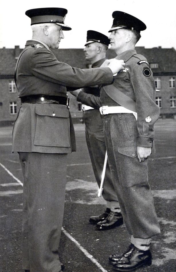 Major Austin 'Bobby' Joyce receiving his MBE in 1952 (Image: Spink&Son/BNPS)