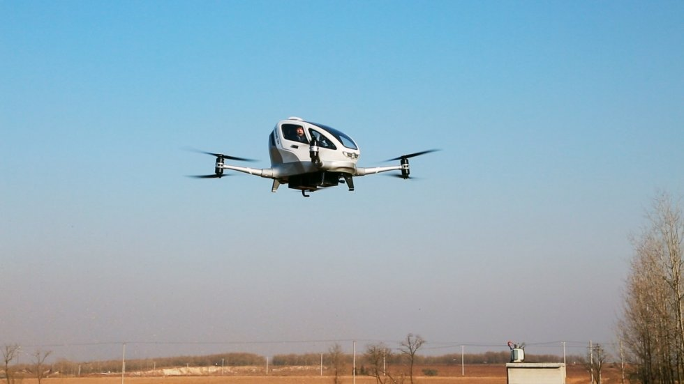 China's self-flying taxi takes first manned flight