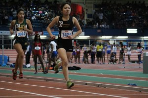 Senior indoor co-captain Stephanie Loo dashes to the finish line. Photo Credit: Yash Sharma