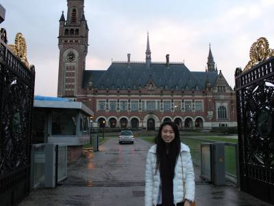 Adrienne stands in front of the Peace Palace at the Hague. Photo courtesy of Adrienne Lee