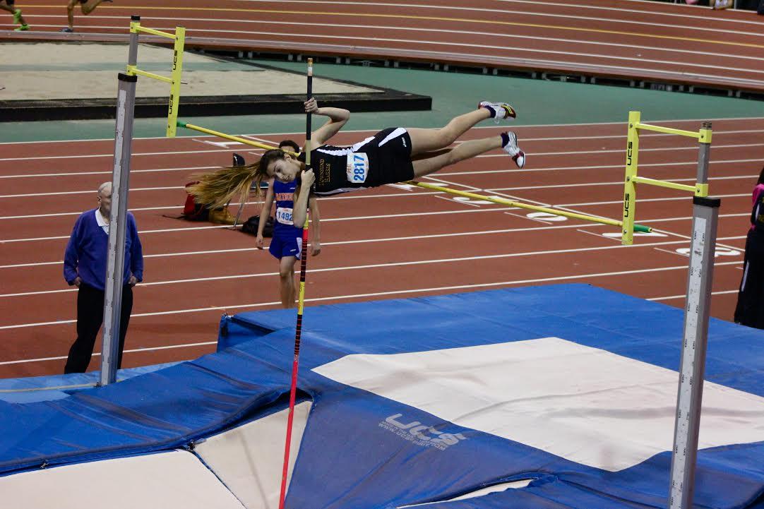 Sophomore Kellie Zestanakis places third in the varsity pole vault. Photo Credit: Jackson Loo.