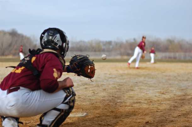 Freshman Alexander Lebeau pitches to catcher and captain senior Daniel Restifo. Photo by Kari Iocolano.