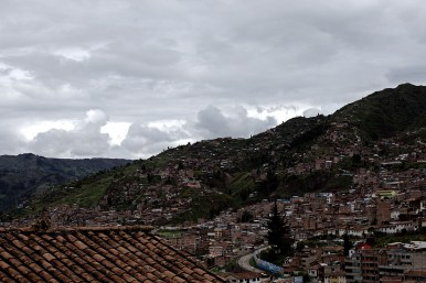 A view from over one of Cusco's red tile roofs.