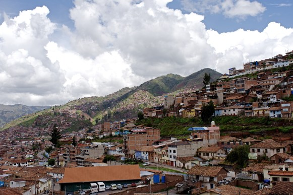 Neighborhoods stretch into the slopes of Cusco.