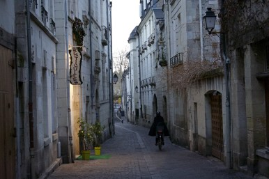 A cyclist makes his way down a street in Tours.