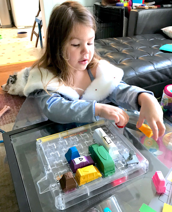 Hazel, a seasoned ThinkFun playtester, checks out the My First Rush Hour prototype.