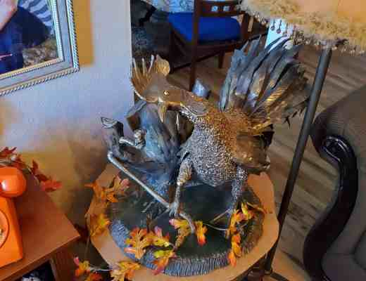 Metal Sculpture by Ron Pecarovich - The Early Bird Gets the Worm - this won best of show at the Kern County Fair