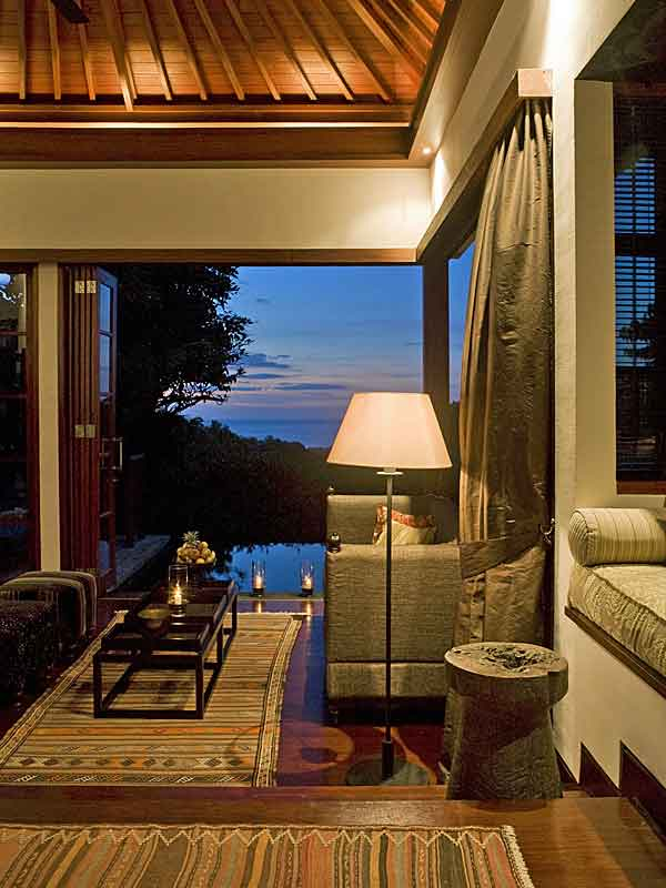 The lounge of one of the pool villas at The Damai at night.