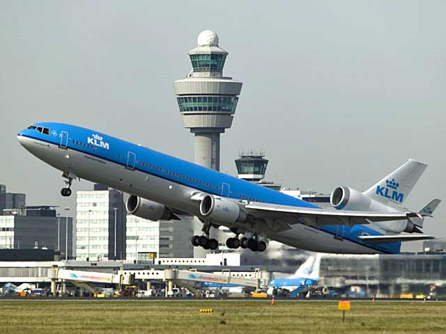 KLM MD-11 taking off. Join in on their contest and win 2 tickets on the farewell flight.