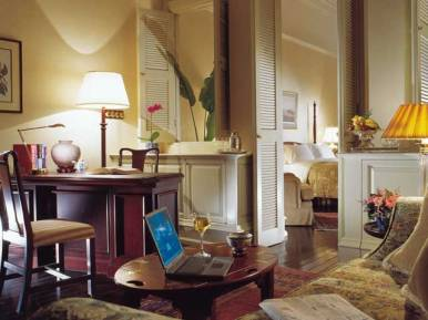 The parlor of a Courtyard Suite at Raffles Hotel, Singapore.