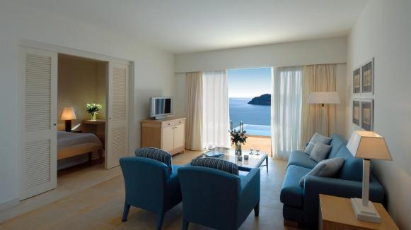 'the living room of a Deluxe Suite at Blue Palace Resort & Spa.