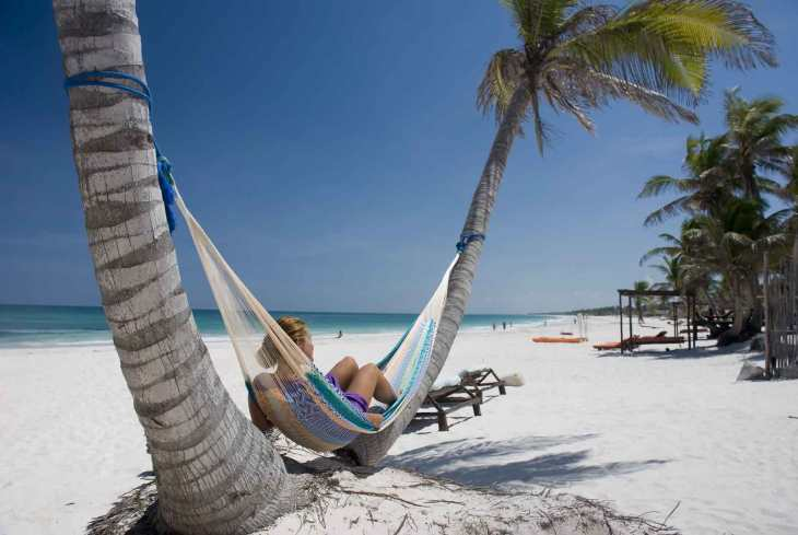 Hammock on a tropical beach. Looks good, doesn´t it?