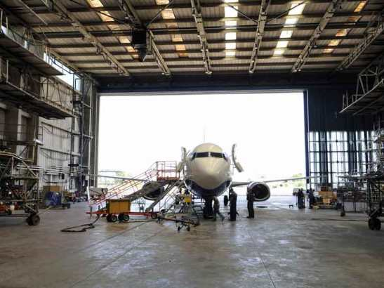 Airplane parked in a hangar.