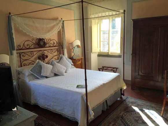 Romantic four post bed at Il Falconiere in Cortona, Italy.