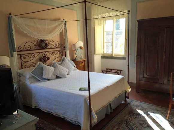 Romantic four post bed at Il Falconiere in Cortona, Italy.