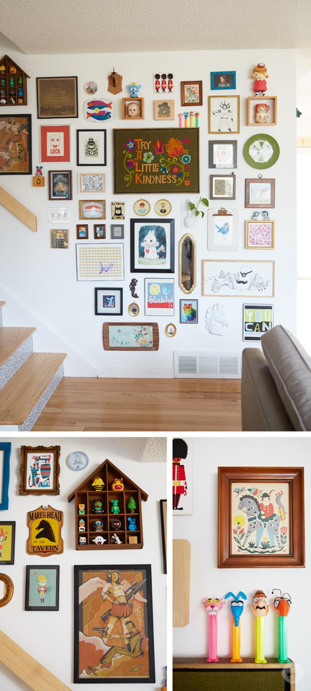 "Tips for displaying art: ""Collage wall"" by a stair case featuring sculptures, prints, embroidery, shadowboxes, collectibles, and other pieces of art"