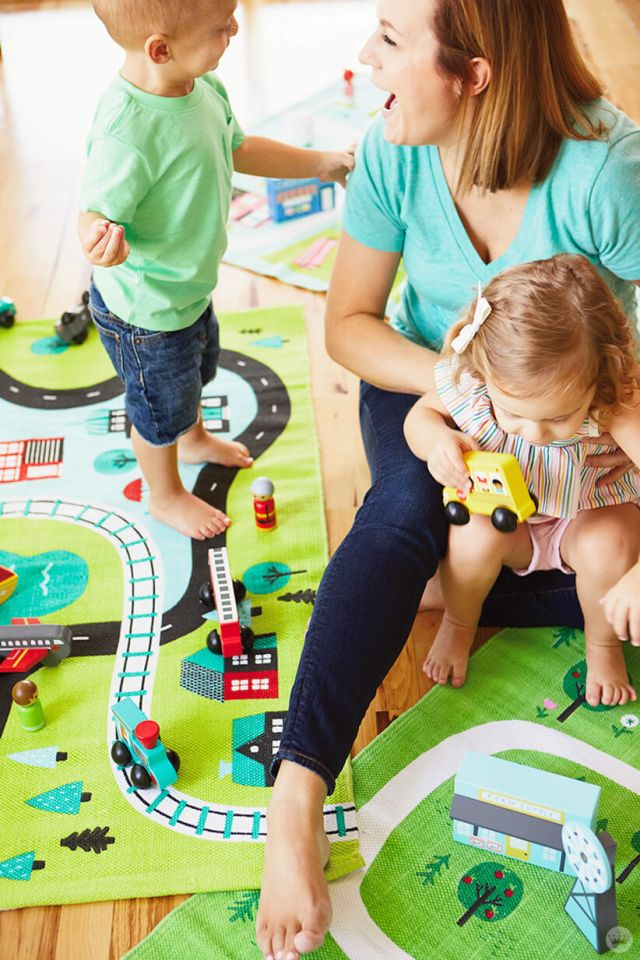 Family playing with Hallmark's new Learn+Play+Discover Toys for Toddlers